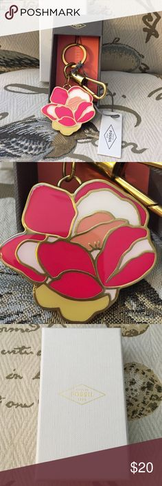 NWT Fossil Key Chain Authentic NWT Fossil Keychain. Pretty pink enamel flower on a brass-tone background. One attached key ring, and one clip. Comes in original boxed packaging. Fossil Accessories Key & Card Holders