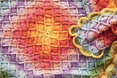 love this beautiful color layout for the Wool Eater crocheted afghan pattern...warning: as you get to the outer rounds, you need more yarn (sometimes more than one skein)