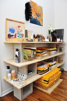 Cinder blocks and wood plank shelving
