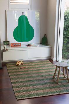 minimalist storage, oversize art, rug.