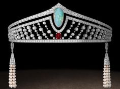 Chaumet was founded in Paris in the 18th century. They still make tiaras, so there are quite a few modern, interesting, sparkly designs about.  This is the old Chaumet Salon in Paris:    Opal, ruby and diamond in a platinum setting, with groovy pearl 'tassels'.