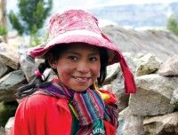 Young local Cuzco girl in traditional dress