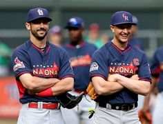National League infielder Troy Tulowitzki of the Colorado Rockies stands with National League infielder Matt Carpenter during the All Star Workout Day 7-14-14