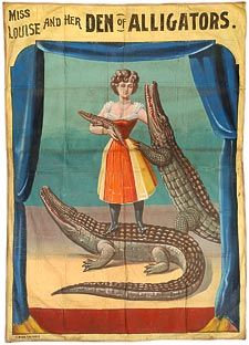 """The banner """"Sigmund Bock, Miss Louise and Her Den of Alligators,"""" along with other circus memorabilia from the Circus World Museum"""