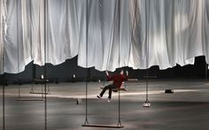 Max Fauconnier swings during a preview of Ann Hamilton's multimedia art installation The event of a thread, at the Park Avenue Armory in New York