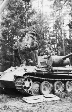 German soldiers repairing a Panzer V Panther. Russia May 1944