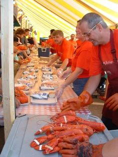 Maine Lobster Festival - a few times a year I would buy some Maine Lobsters and have a seafood festival. Clams, mussels, bisque or chowder, lobsters and then if there was any room left we would eat the corn on the cob and boiled potatoes LOL :) - Desert - forget it - never room for that.