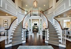 Toll Brothers Dramatic Two-story foyer with elegant curved staircases - Luxury Homes Foyer Staircase, Double Staircase, Staircase Design, Winding Staircase, Entry Stairs, Stair Design, Spiral Staircases, Flur Design, Foyer Lighting
