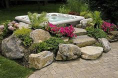 do you like this built in look for a hot tub surround, gardening, outdoor living, pool designs, spas, Landscaped Hot Tub surround with moss rock steps