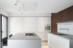 Apartment Renovation in Paris IV is a minimal apartment renovation located in Paris, France, designed by Cube Architects