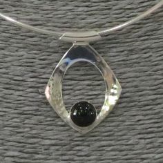 A personal favorite from my Etsy shop https://www.etsy.com/listing/600464500/sterling-silver-modern-pendant-with-onyx