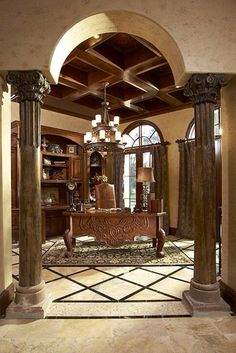 Greek columns and a chandelier? Oh yeah, now that's a classy home office.