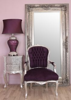 Stunning purple velvet shabby chic armchair The wooden frame has carved detail curved Louis style legs and is finished with silver leaf