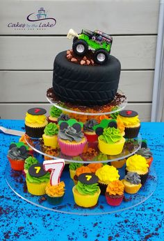 MONSTER TRUCK CAKE  After consultation with one of my young clients about his 7th Birthday cake, we came up with this buttercake 'tyre cake' with a monster truck on top. The cake then sat atop of this tower of cupcakes finished in a variety of colours of buttercream  Happy Birthday Mykah  www.cakesbythelake.com.au www.instagram.com/cakes_by_the_lake