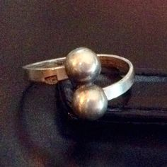 Gorgeous, Rare 1950's Handmade Ring from Iraq Simple, elegant silver ring with unique artist stamp on outside portion of band. Handmade-mid 20th Century (1950's) Iraq.  Gorgeous...rare! Handmade Artist Stamped Jewelry Rings