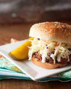 Alabama Style Pulled Pork Sandwiches will remind you why you love summer. These delicious sandwiches are made using an easy pulled pork recipe that you'll keep around for years to come.