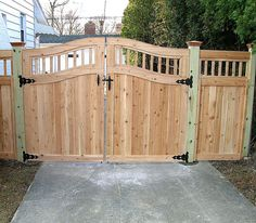 wooden fence gates designs Custom Arched Good Neighbor Wood Fence and Gate by Elyria Fence Wood Fence Gate Designs, Wooden Fence Gate, Fence Doors, Fence Gates, Wood Fences, Fencing, Cedar Gate, Horse Fence, Rustic Fence