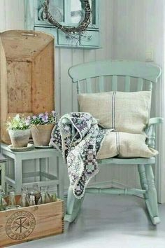 Pretty Farmhouse vignette with chippy rocker chair and vintage boxes and bottles. Flowers