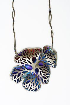 Safira Blom, Self Proliferating Patterns: Organic Neckpiece, 2012. Titanium, 925 silver: hydraulic pressed, hand pierced, torch coloured and constructed.