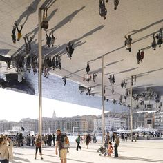 A series of new cultural venues have sprung up along the waterfront in Marseille including a mirrored pavilion by Foster + Partners