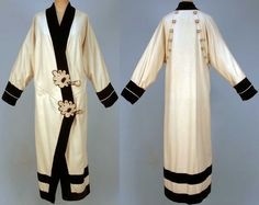 Wool and velvet coat, ca. 1912. Cream felt kimono style trimmed in black velvet with cream piping. Two large corded leaf-form appliques and corded button and loop closures. Back decorated with two rows of buttons lined in cream satin with ribbon binding.