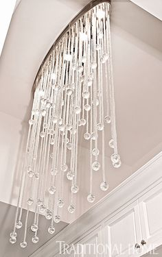 A custom-designed drop-glass chandelier dazzles in this 10-foot-high room. - Photo: Michael Garland