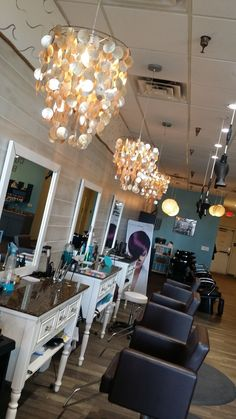 Inspiration by Drift Salon. Row of wilmington stylist stations, with the Avant Styling Chairs.  Mats and stylist rolling stool all provided by Minerva Beauty.  Together they give our salon the beachy warm feeling that helps our guests feel more at home. In the background you can see the Vantage ultra backwash system also by Minerva, which we have had more than one guest fall alseep in.  #minervasalon2015 #driftsalon @bloomdotcom