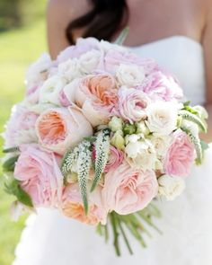A vision in pink: Several types of garden roses, peonies, ranunculus, hellebores, spray roses, and Veronica