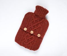 Inspired by traditional Scottish patterns, this luxurious hot water bottle sweater is made with 90% Scottish Wool & 10% Silk of the highest quality making this sweater extra special.  This listing is for sweater / cover only Does your hot water bottle need some tlc?  Yes... then why not wrap it up in this luxurious and cosy hot water bottle sweater?  Designed and hand knit by me with a Scottish wool and silk blend yarn in russet. It features an entwined cable design centre panel set ...
