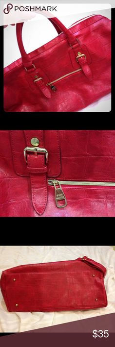 Steve Madden Red Leather Travel Bag Perfect for your next weekend get away! Cherry Red Leather duffle by Steve Madden. Hand carry straps or over the shoulder. Adorable polka dot lining *with stain from make up spill* Steve Madden Bags Travel Bags