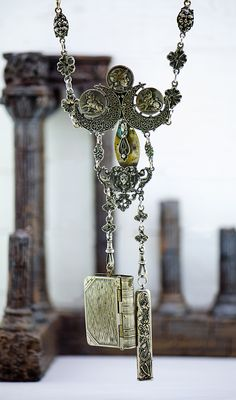 """This is a rare and beautiful artifact of magick; of daily use to a practicing witch who called herself """"Adelia"""".  She wore this on her belt and used it daily in her works with spells and rituals.  This is a beautifully-intricate chatelaine that was used to hold a flat pencil, hold her herbs and dry potions, and used to hold various tools of her works as pinned and chained to her chatelaine.  Because it was her daily companion, trusted and handy tool for quick-work she spelled this c..."""