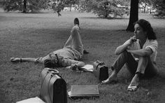 Actors Montgomery Clift (1920 - 1966) and Elizabeth Taylor (1932 - 2011) lounging on the grass during the filming of 'Raintree County' in Indiana, 1958.