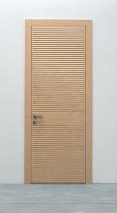 Modern interior swing door in oak with wave textured veneer