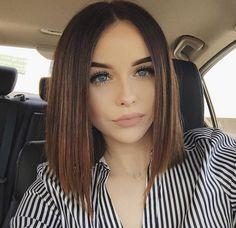 Sleek haircut by Acacia Brinley