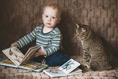 Child and cat. Photo by Monika Małek — National Geographic Your Shot