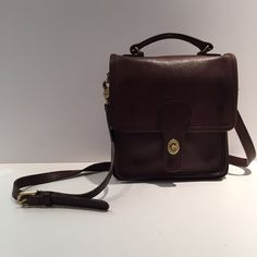 Brown leather vintage coach rose body This Gorgeous cross body is a great vintage piece for any coach lover! It is made of high quality brown glove leather. Made in the UNITED STATES (back when coach used to manufacture here. Inside is clean. Corners show some sign of wear (not very noticeable) like any vintage bag. IThis is an EXCELLENT price for this bag. Coach Bags