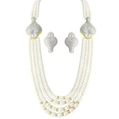 Isn't the JPearls Starling Bridal Set just absolutely stunning? Pair this with an Anarkali and you are definitely the show stopper for the day. #pearls #BridalWear #beauty #elegance