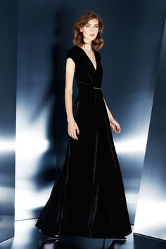 VELVET - This ESCADA black velvet dress makes classic and graceful atmosphere. Also, this dress is a retro looking. Gold colour decoration on middle of dress makes more luxurious and high-class fashion.