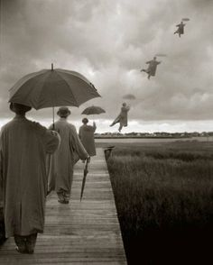 Bryce Lankard: Men with Umbrellas Flying into the Sky