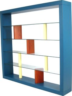 Fontane Arte bookcase in wood and glass by Ettore SOTTSASS in 1993. Structure in blue, yellow and natural lacquered wood, glass shelves. In good vintage condition.