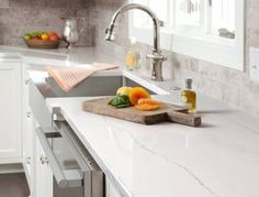 The look of marble countertops with none of the maintenance, Cambria quartz countertops are easy to clean and more durable than marble. Cambria Ella mimics the look of marble, a white countertop with dove-gray undertones and gray veins running laterally. Cambria Quartz Countertops, Granite Countertops Colors, Outdoor Kitchen Countertops, Kitchen Countertop Materials, Granite Kitchen, White Kitchen Cabinets, New Kitchen, Kitchen Island, Kitchen Ideas
