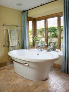 traditional bathroom with freestanding tub and great view