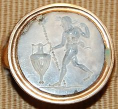 Sard gem, slightly burnt, engraved with a nude young satyr running to the right; he wears a wreath and holds a thyrsos and an amphora. Culture/period Roman Imperial. Date 1stC-3rdC