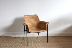 mimbre silla sillon Danish Wicker Armchair  Designer Unknown designer  Description Super stylish mid-century armchair in cane and metal. In excellent original condition. Made Denmark c1960.  Dimensions: L80 H77 D65  Status: In showroom Ref: 1447  Price $595