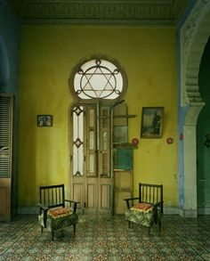 Bohemian Wornest entry with Moroccan tiles and arches