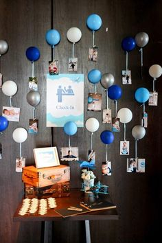 Airplane Themed Birthday Party: cluster photo balloons over a table like a chandelier