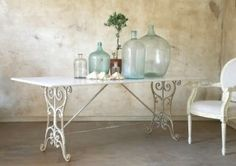 French white dining table with iron base - i almost think you could make something simular to this using a pair of singer sewing machine legs and some creativity! we'll see!