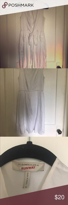 BCBG MAXAZRIA RUNWAY white blouse dress White silky wrap around dress. Lightly worn. Comes down over the knees. About an inch rip at seam at the bottom. Easy fix BCBGMaxAzria Dresses Midi