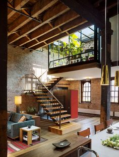 Loft space with open staircase and brick walls