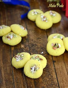 The malai peda is a peda recipe which can be prepared within minutes. An Indian dessert delicacy, malai pedas are prepared from condensed milk mixed with milk powder and sugar .Serve malai pedas garnished with crushed nuts. Indian Desserts, Indian Sweets, Indian Dishes, Indian Food Recipes, Pakistani Desserts, Navratri Recipes, Navratri Food, Gujarati Food, Peda Recipe
